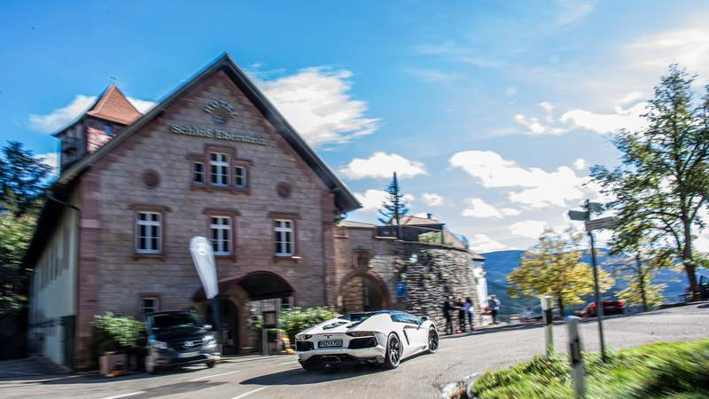 Castle Eberstein, Lamborghini Aventador, sports car touring, travel with sports cars
